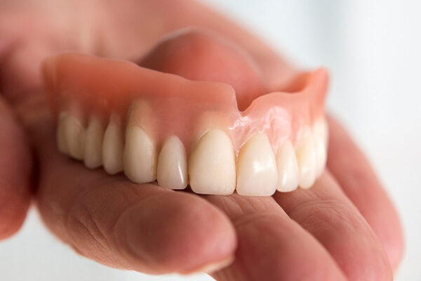 False Teeth Falling Out Dream Meaning: What Does It Mean? Let's Interpret